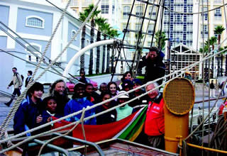 Local children joined the ship in South Africa on an extended training cruise.